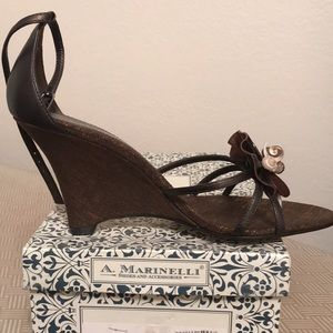 A. Marinelli. Never worn! Metallic brown.